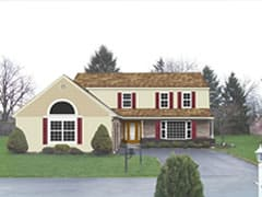 exterior of home with light color palette for siding and accents